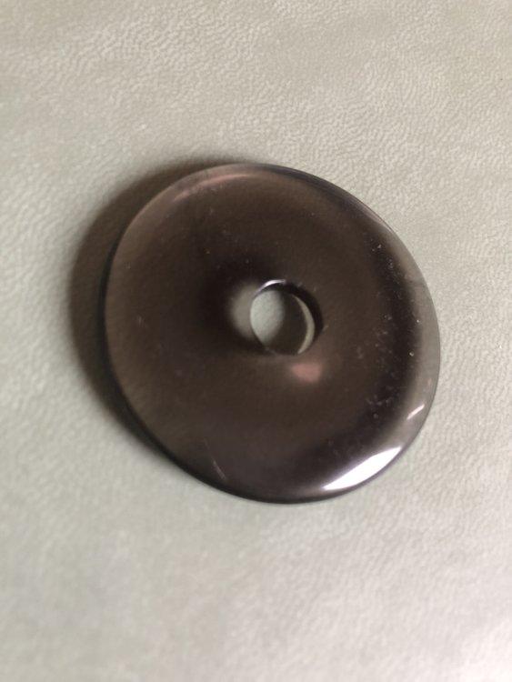 Grote donut van rookkwarts
