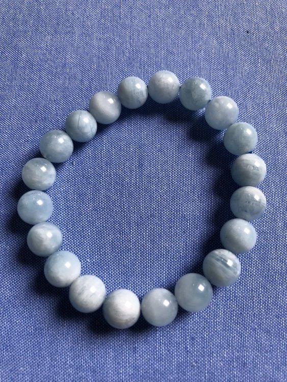 Armband van zacht lichtblauw aquamarijn (kralen 10mm)