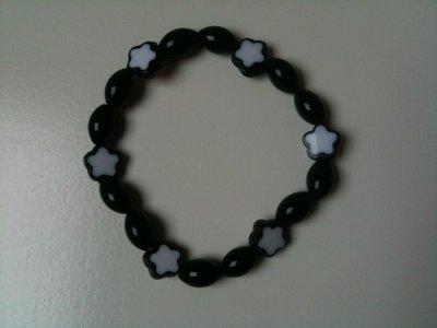 Armband met onyx en sterretjes